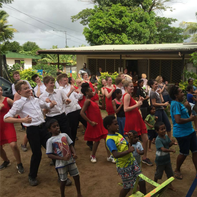 Fairbanks teens learn a line dance from Fijians at Treasure House orphanage, after they performed.