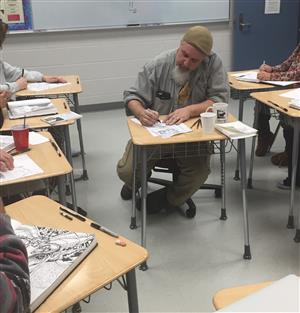 Artist Jamie Smith teaches art at Golden Heart Academy