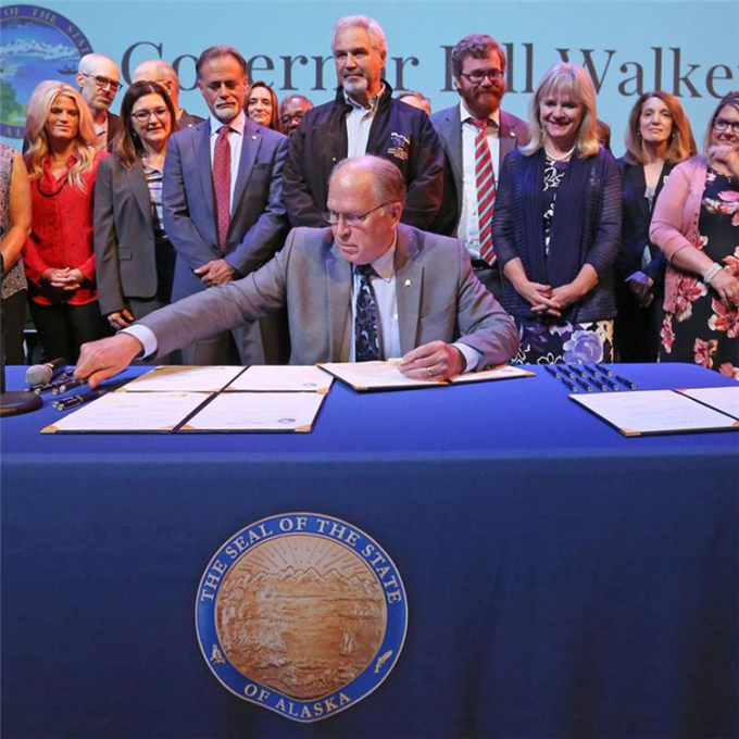 Walker signs education bills at teacher welcome back day