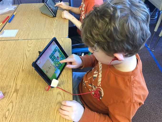 Anderson Elementary 1st grade student, Brennan, uses his iPad to work on math in Susan McNeer's class.