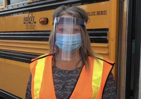 person wearing mask and face shield