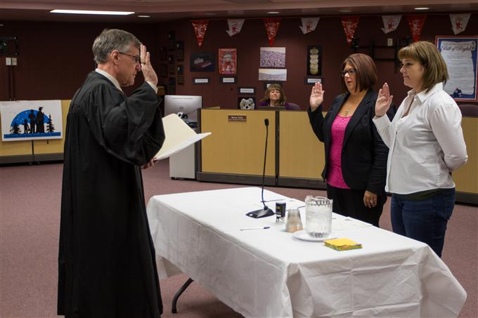 Re-elected school board members Heidi Haas and Lisa Gentry sworn in